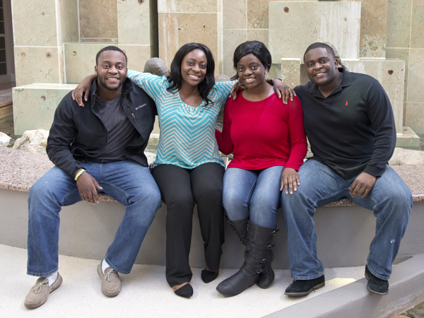 "The Adah offspring are, from left, Esosa ""Sosa"" Adah, Dr. Ameze Adah, Osasu Adah and Omonuwa Adah."