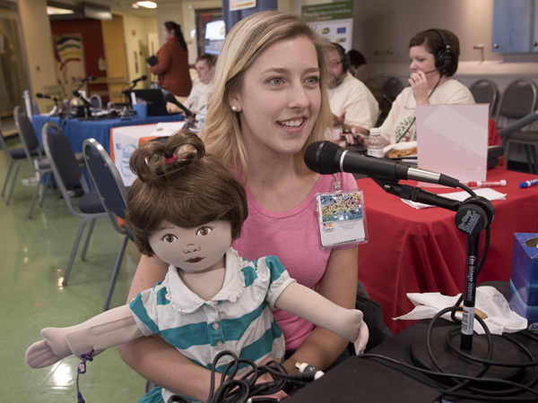 Mullen has one of Batson Children's Hospital's MediKin teaching dolls to show on-air personalities.