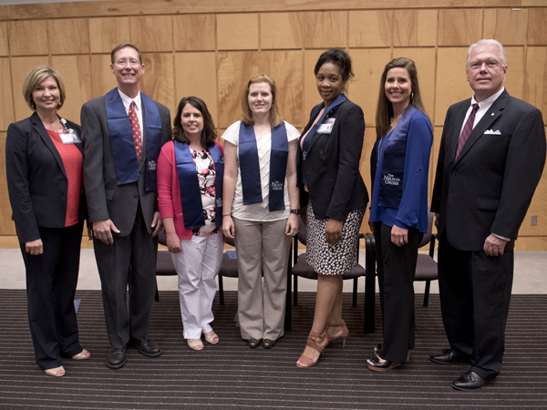 Five finalists were chosen from the Nelson Order inductees to compete for the TEACH Prize. Pictured from the left are Vice Chancellor LouAnn Woodward; William P. Daley, M.D., School of Medicine; Kim Douglass, M.S.N., School of Nursing; Jennifer Bain, D.M.D., School of Dentistry; Juanyce Taylor, Ph.D., School of Health Related Professions; Bridget Chisolm, Pharm.D., School of Pharmacy; and Alon Bee, Regions Bank city president of metro Jackson.