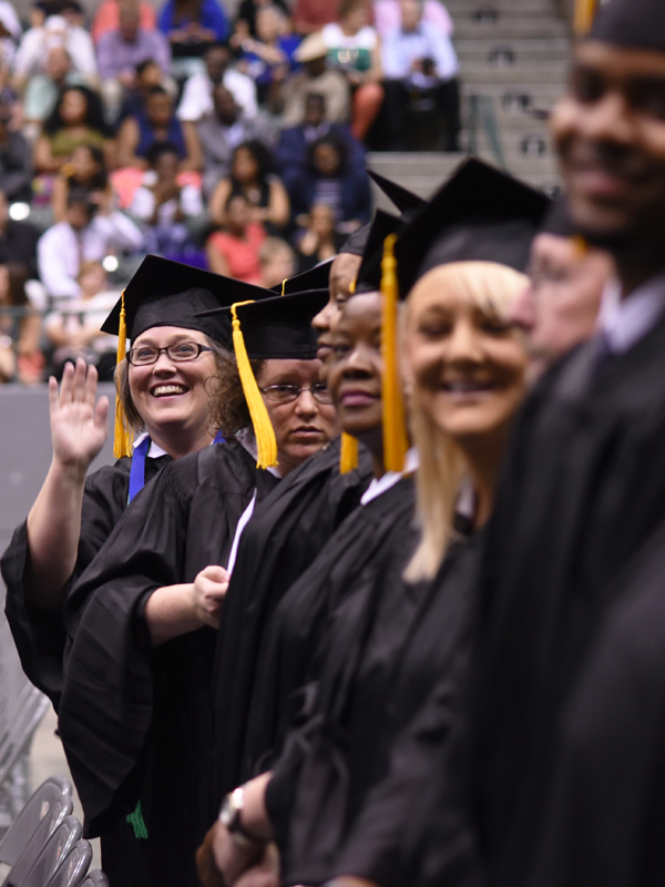 A new UMMC graduate gives friends and family a wave.