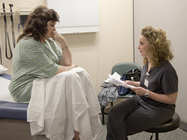 OT2 Devin Hart, right, gives her patient practical advice on ways she can cope with anxiety.