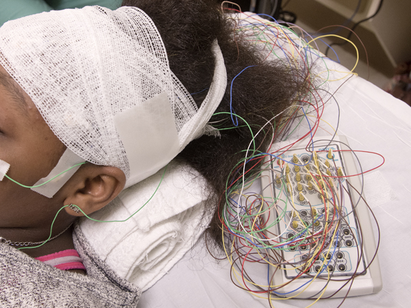 Gray is wired with leads for her EEG in the new Pediatric Neurophysiology Lab.