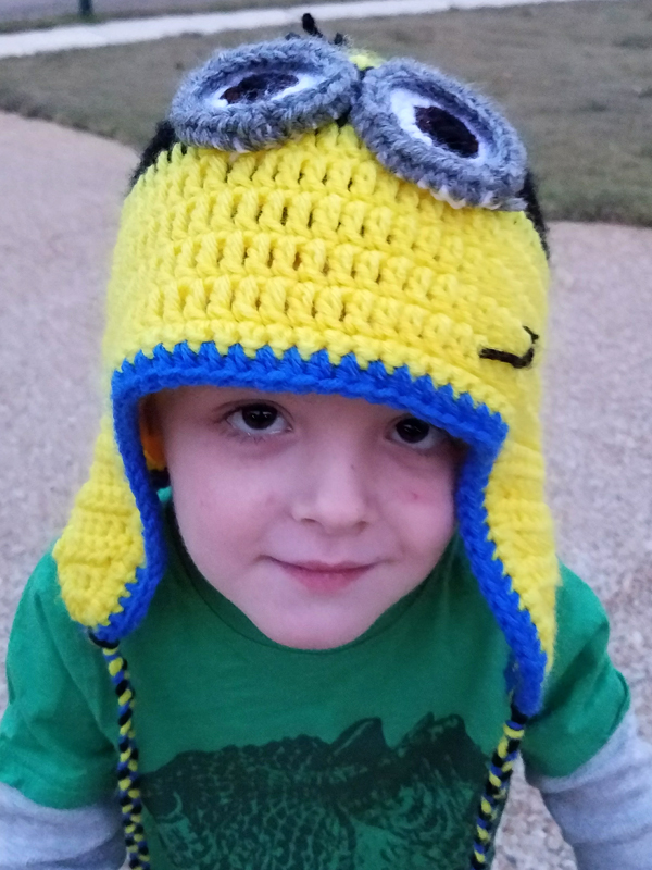 Colt Fulton, son of DIS employee Eli Fulton, wears a Minion hat crafted by Jackie Robinson.