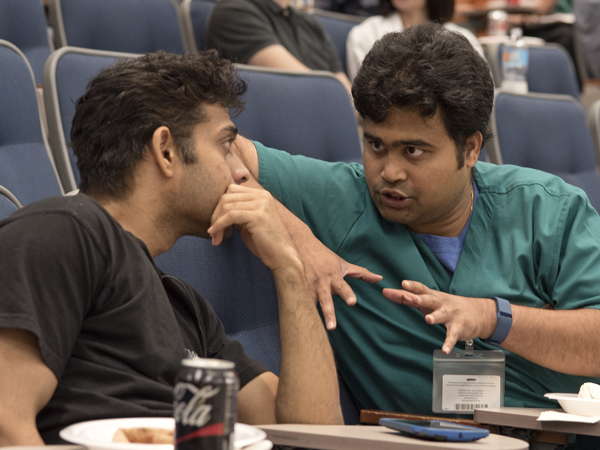Vallabhaneni, right, describes X-rays to his seminar partner.