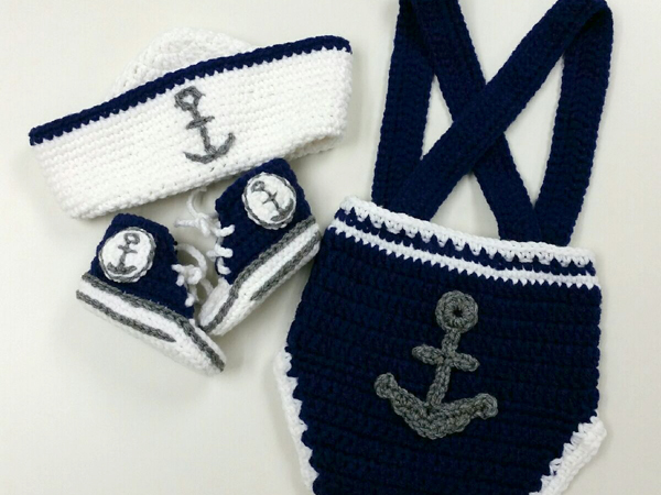 Robinson created a baby's anchor-themed sailor suit complete with hat and booties.
