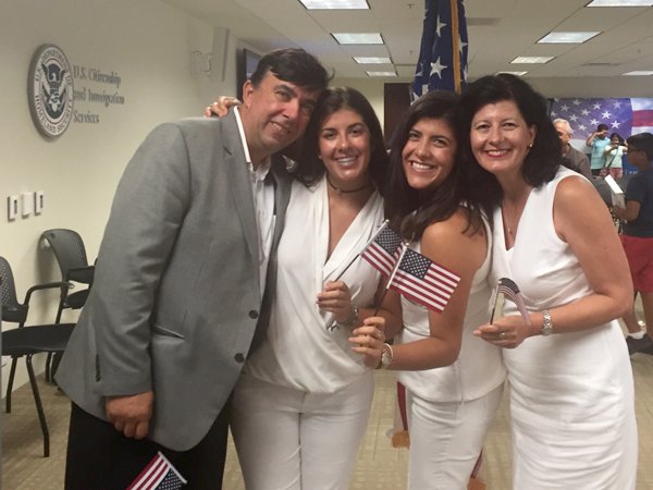 Sara Kiparizoska, second from right, congratulates her parents, Zan Kiparizoski and Gordana Kiparizoska and sister Eva Kiparizoska immediately after their naturalization ceremony in New Orleans.