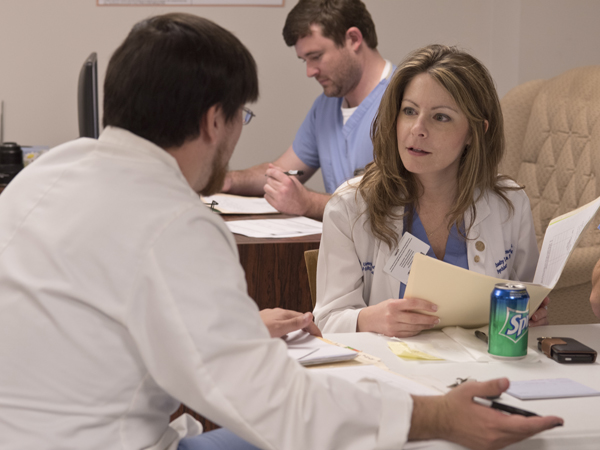 Dr. Chasity Torrence, right, and fourth-year medical student Jonathan Baker review a case on October 15 at the Jackson Free Clinic.