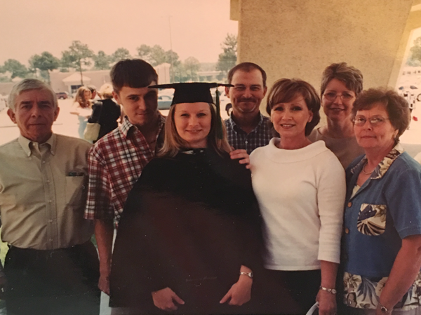 At her School of Medicine commencement ceremony in 2003, Shoemake is congratulated by her family -- from left, father Paul Shoemake, brother Blake Alford, uncle Richard Murphree, mother June Alford, aunt Bobbie Murphree and grandmother Laneita Murphree.
