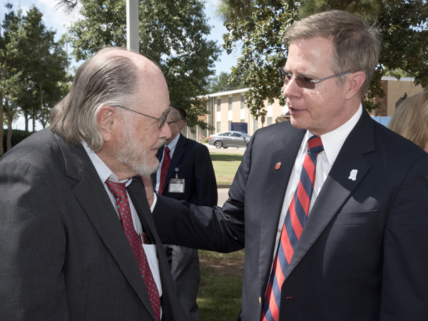 Dr. John Bower, left, visits with University of Mississippi Chancellor Jeffrey Vitter at the naming ceremony of the John D. Bower School of Population Health.