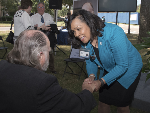 Dr. Bettina Beech, founding dean of UMMC's new John D. Bower School of Population Health, greets the school's namesake.