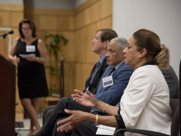Oleta Fitzgerald, right, makes a point during a panel discussion moderated by Dr. Leslie Hossfeld, far left, at podium. Other panelists pictured are, from left, Dr. Gregory Bohach and Mike Espy. Not visible is panelist Dr. Dolphus Weary.