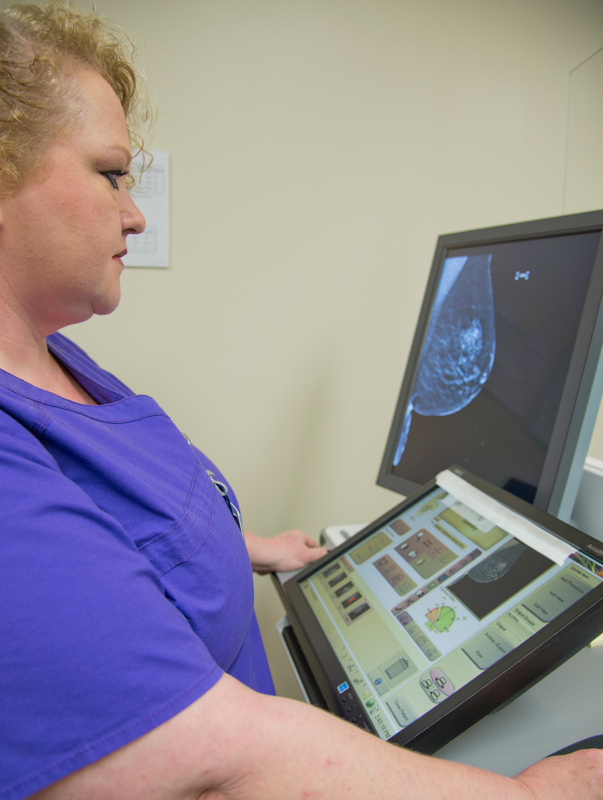 McCammon examines a mammography scan.