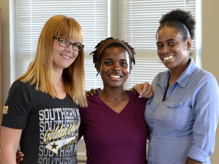 Whiteside, center, had two strong women advocating for her recovery: Dr. Amy Chasteen Miller, left, her academic advisor at the University of Southern Mississippi, and her mother, Angela Whiteside.