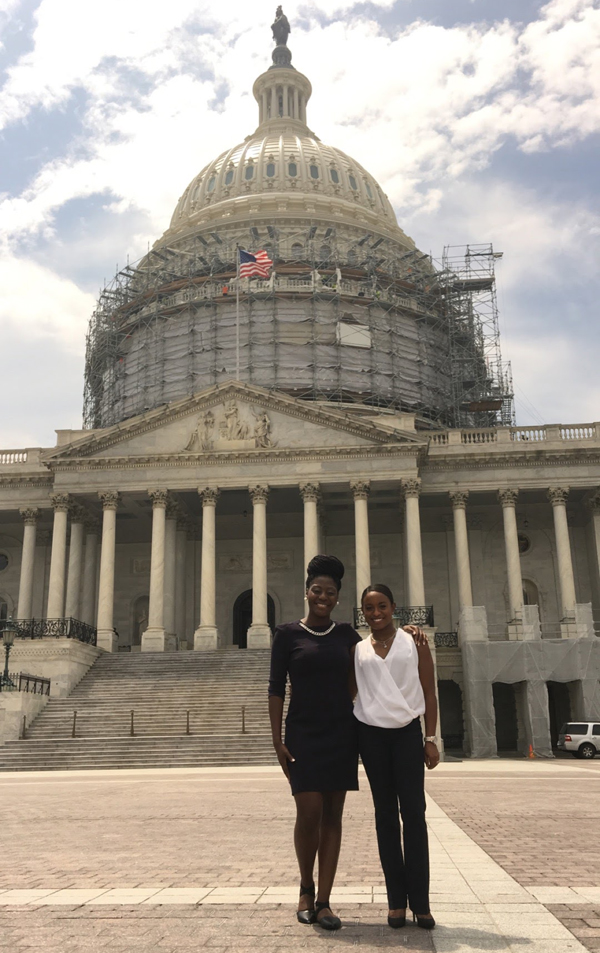 Among the students who were awarded fellowships to the RESULTS International Conference in Washington, D.C., in June are Nneamaka Ezekwe, left, and Morgan Davis, who visited the U.S. Capitol in the midst of a dome renovation project.