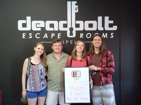 "Team members, from the left, dental students Alyssa Swenson and Ronald Young join Sistrunk and his wife Paulina to conduct ""business research"" at Deadbolt in Tupelo as team ""A Team Has No Name."""