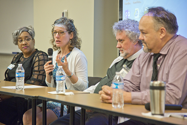 Doris Whitaker, left, director of pastoral services; Rabbi Debra Kassoff, second from left, of Beth Israel Congregation; Murphy, second from right; and Darrell Troth, a Jackson Medical Mall Foundation employee, discuss religion's role in the workplace.