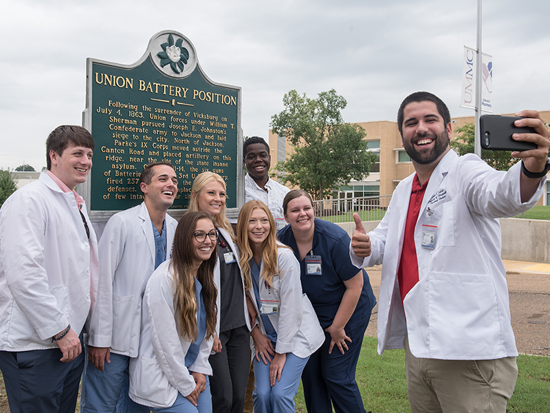It's selfie time for Justin Cabral and his School of Pharmacy  classmates, from left, Cain Young, Chad Bowman, Kristen Garcia, Ashton Smith, Alley Harper, Martin Love and Megan Harlow on their self-guided campus tour.