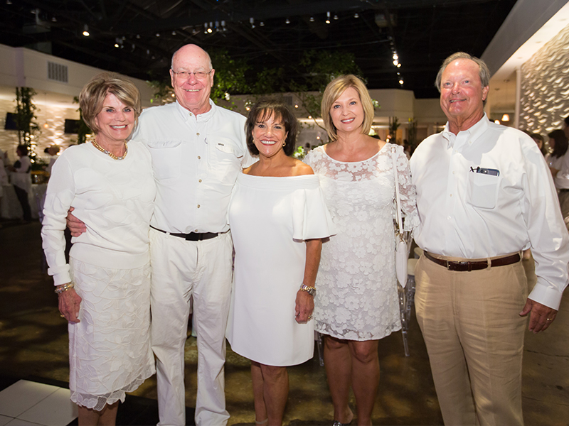 Smiling over a successful BankPlus Presents Enchanted Evening fundraiser are, from left, Suzan Thames, Dr. James Keeton, Sara Ray, Dr. LouAnn Woodward and Sidney Allen.