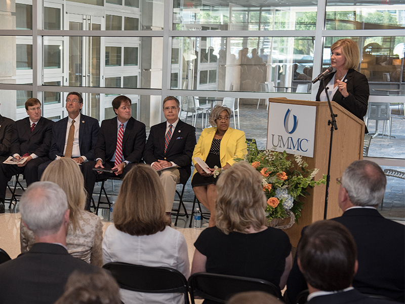 Dr. LouAnn Woodward, UMMC vice chancellor for health affairs and dean of the School of Medicine, addresses dignitaries attending dedication ceremonies for the new School of Medicine.