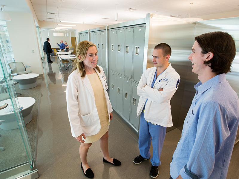Third-year medical student Laura Lee Beneke, left, fourth-year medical student Taylor Mabry, center, and first-year medical student Kirby Parker chat inside a student lounge inside the new School of Medicine.