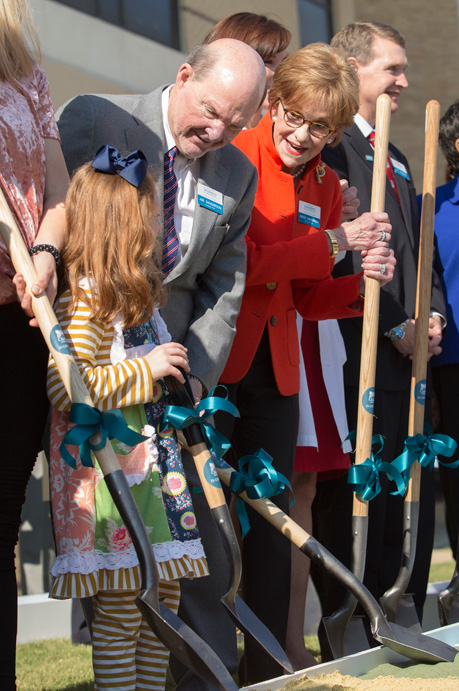 Joe and Kathy Sanderson, co-chairs of the Campaign for Children's of Mississippi, help Batson Children's Hospital patient Avery Bell in breaking ground on the new children's tower.