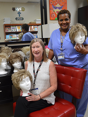 UMMC Public Affairs assistant director of media relations, Ruth Cummins and her siblings donated 10 wigs that had belonged to her mother, who died of liver cancer last year. Janice Johnson, manager of the Cancer Institute Patient Resource Center, oversees the wig room.