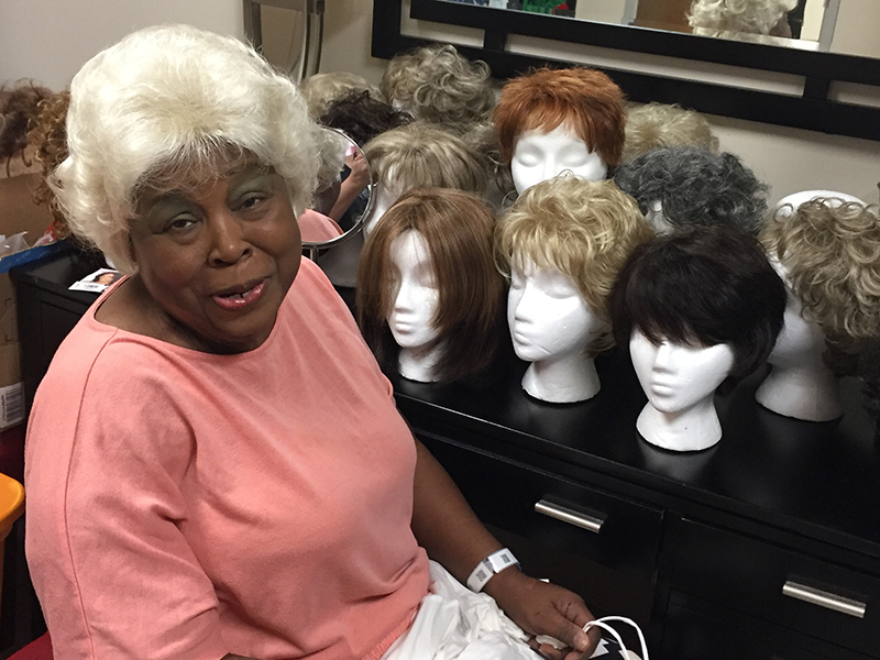 Terethia Goulding models her newly coiffed wig in the UMMC Cancer Institute  Patient Resource Center. 5203d8b4ad
