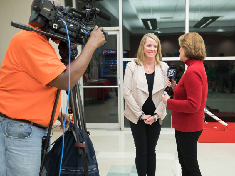 Melanie Christopher of WJTV interviews Friends of Children's Hospital board member Jill Dale prior to the start of BankPlus Presents Light A Light. The event is the nonprofit's oldest fundraiser.