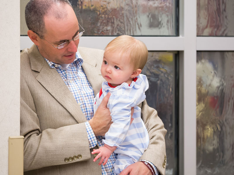 David Dale holds daughter Stella Grace at BankPlus Presents Light A Light.