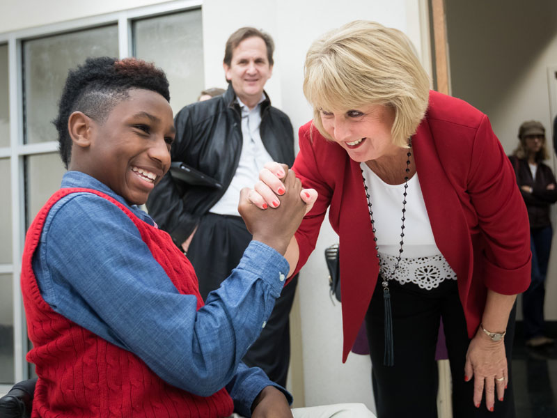 Batson Children's Hospital patient K.J. Fields gets a handshake from Mississippi First Lady Deborah Bryant at BankPlus Presents Light A Light, a Friends of Children's Hospital fundraiser. The two shared the honor of lighting the hospital's Christmas tree during the event.