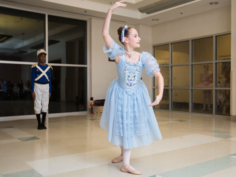 "Ballet Mississippi's Emma Butler dances as a girl doll during a scene from ""The Nutcracker."" Looking on is dancer Wilton McDowell, dancing the role of a soldier doll."