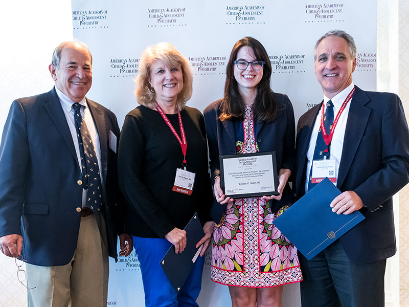 Salter, second from right, is congratulated by two of her mentors at the 2017 AACAP Annual Meeting: Bryant and Merideth, who are standing on either side of her. With them is Dr. Greg Fritz, outgoing AACAP president. (Photo courtesy of AACAP)