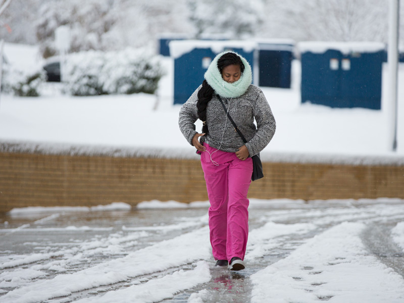 Shundria Washington, a patient service coordinator in the School of Dentistry, is bundled agains the cold while walking across the  UMMC campus on Friday.