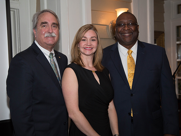 Deming-Jefcoat with Dr. David Felton (left), Dean of the School of Dentistry, and Dr. Acie Whitlock (right), current Dental Alumni Board President at the Dental Alumni and Friends dinner Friday, February 10.