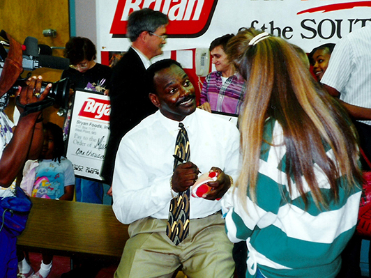 Football great Walter Payton signs autographs for patients and families at an event at UMMC in the early 1990s.