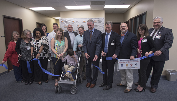 Pediatricians, health care professionals and city of Biloxi leaders join Lauren Bradshaw and son Andrew Fillingame in cutting the ribbon at the new Children's of Mississippi specialty clinic in Biloxi. Andrew, center, is a patient of neurologist Dr. Mark Lee at the clinic.