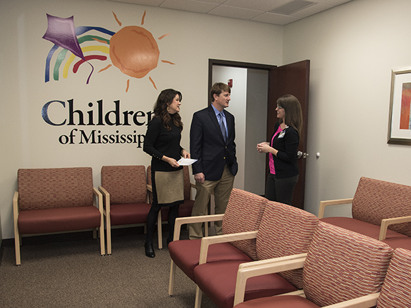 Ashley Williams, right, pediatric nurse, takes Dr. Van Wurm and his wife Kim on a tour of the clinic.