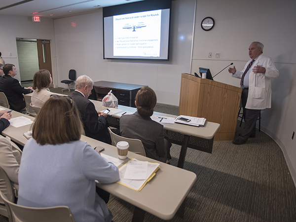 Chief Medical Officer Michael Henderson, upper right, talks to Medical Center executives, physicians and administrators before Leadership Rounds.