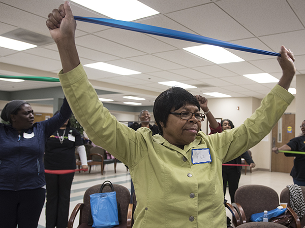 Annie Davis participates in the exercise demonstration led by UMMC occupational therapists Summer Brewer and Diane Satterfield.
