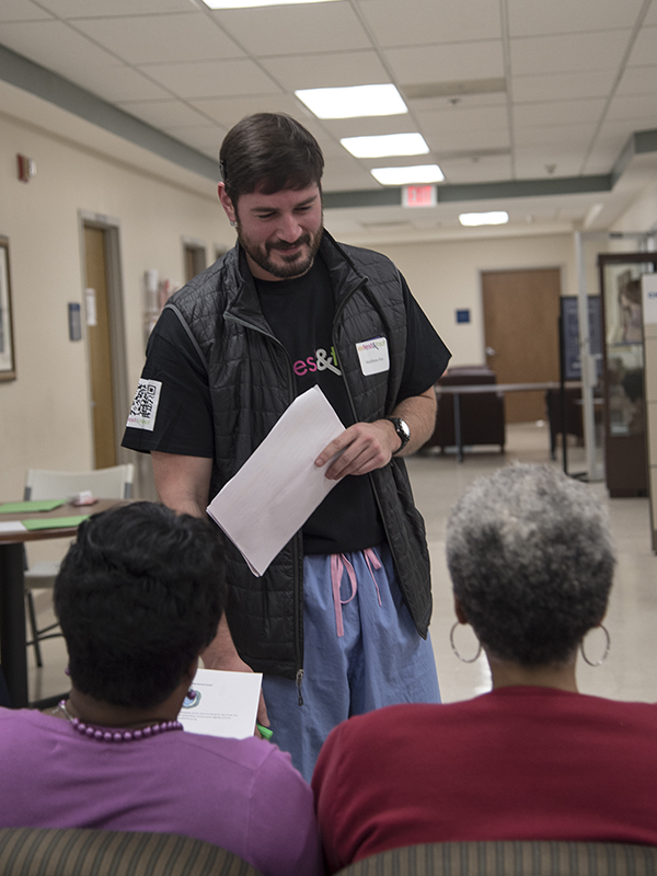 Volunteer Matthew Alias, a first-year medical student, prepares to escort a woman to her first screening.