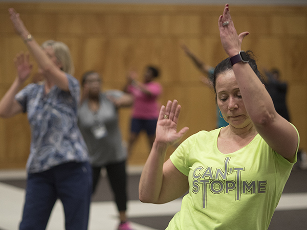 Jessie Lindsay, director of operations for The MIND Center, takes part in UMMC's Zumba class for employees.