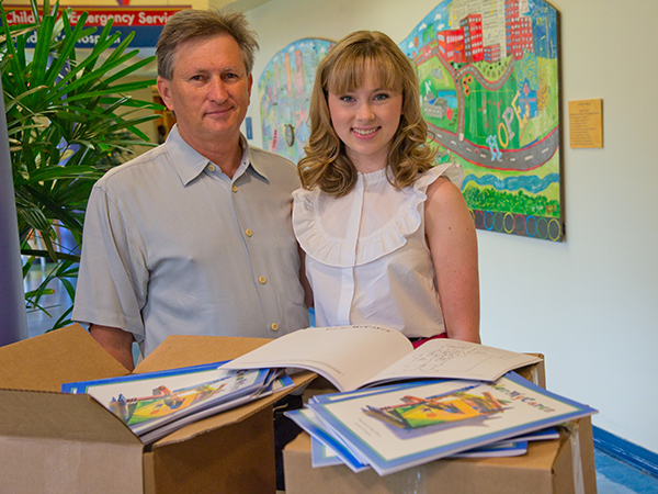 Jack and Emma Herrington brought thousands of Color My Cares coloring books to Batson Children's Hospital June 30. The books include lighthearted images and Mississippi scenes as well as pages for journaling.
