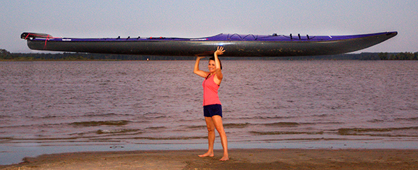 With a little help from friends, Richards hoists her 40-pound kayak.