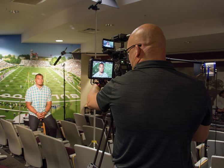 Brian Utley, video producer with the MSU Extension Service Agricultural Communications, records one of the public service announcements featuring Prescott.