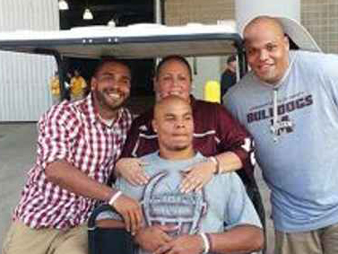 Prescott, center, pauses for a photo with his mom, Peggy, and brothers, Tad, left and, Jace, right, during her battle with colon cancer.