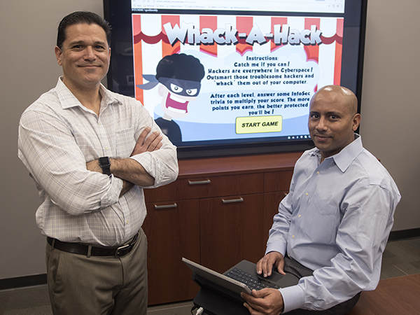 Adrian Castillo, left, a DIS interactive digital developer, and senior web software developer Venu Peddireddy created Whack-A-Hack,