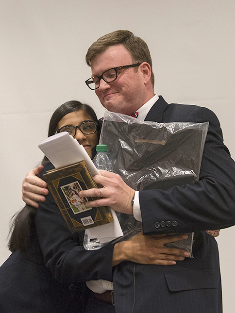 STAR Lisa Biswas presents a plaque of recognition and a copy of Randy Pausch's The Last Lecture - signed by all of the STARs - to Ingram.