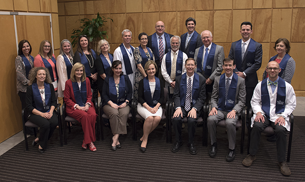 Nelson Order inductees include, back row from left, Dr. Michelle Palokas, Katie Hall, Dr. Janet Harris, Tina Ferrell, Dr. Marianne Conway, Dr. James Brantley, Dr. Susan Warren, Dr. Scott Phillips, Dr. David Brown, Dr. Joshua Fleming, Dr. Bela Kanyicska, Dr. Corey Jackson and Dr. Janet Slaughter; and front row from left, Dr. Lique Coolen, Dr. Sherry West, Asher Street,  Dr. Penny Rogers, Daley, Dr. Calvin Thigpen and Dr. Zeb Henson.