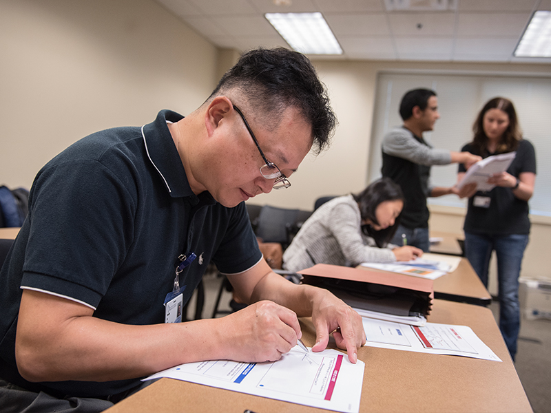 Xiaojian Liu checks over his class notes. Liu is one of five students in the Department of Data Science's Ph.D. program.