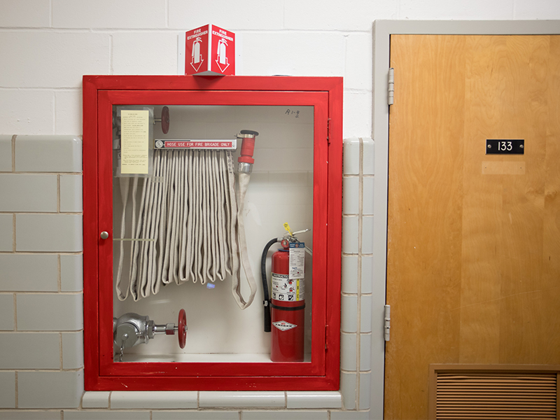 Accessible fire extinguishers and hoses throughout the Medical Center help employees and students take needed action in an emergency.